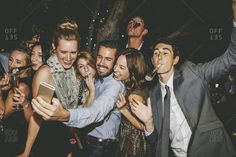 Friends with noisemakers taking a selfie together at a party