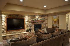 Fantastic Cool Basement Ideas for Media Room with Exposed Stone Wall Decor and Big TV Wall Mount also Cozy Grey Sofa Sets