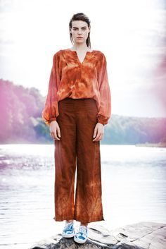 "linen wide leg pant in rust 60% linen and 40% cotton high wasted wide leg pant with 2"" slit on side fit to hang just above the ankle 28"" l inseam extra small- 27 small- 28 medium- 30 large- 31"