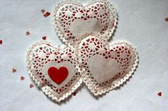 Those paper heart doilies, here's a cute link for a DIY craft with red heart candies.