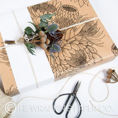 Wrapco Flower Tribe gift wrap. Decorated with Eco Matt White belli-band and adorned with micro bunch of native flowers.