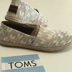 TOMS. Chevron tribal pattern. 8. Awesome pair of TOMS!  Blue on cream Chevron tribal pattern. Size 8. See pic 3. Small smudge on toe and small color blur on inside one shoes Not noticeable when wearing. TOMS Shoes Flats & Loafers