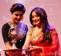Madhuri Dixit and Priyanka Chopra take the stage to light the traditional lamp at the launch of Dilip Kumar's autobiography.