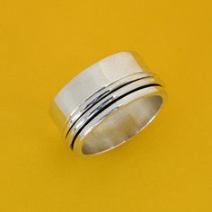 Off-Center Two Band Sterling Silver Spinner Ring by PAZ COLLECTIVE