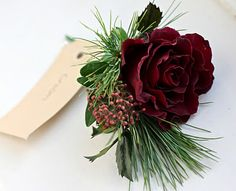 Winter/holiday boutonniere to coordinate with holiday bouquet