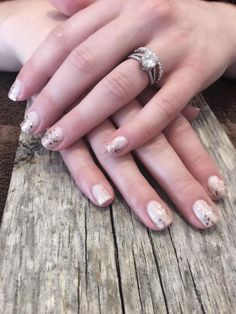 "Gel Manicure in Artistic ""In Bloom"" with rose gold glitter."