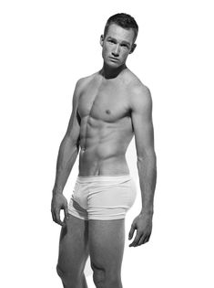 """Greg Rutherford poses in underwear for the """"Stars of the London Olympics 2012"""" special issue of Attitude Magazine October 2012."""