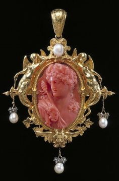 Bacchus pendant, Paris, France, circa 1854, by François-Désiré Froment-Meurice. Coral, carved as a cameo, and set in a gold frame hung with pearls and rose-cut diamond sparks set in silver.