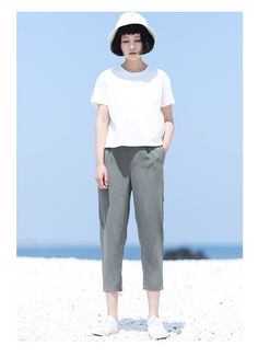 I love how simple this is! Grey slacks with a basic white tee and a matching bucket hat!