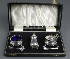 Lot 540, A silver 3 piece condiment set and spoons Birmingham 1975 132gr, est £80-100