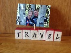 Wooden blocks painted, letters added, crackled and modge podged. Then add small nail with clothes pin to hold a special photo.