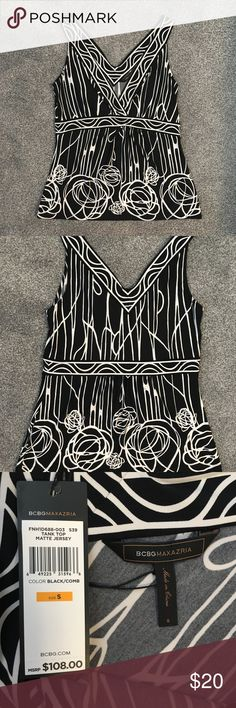 "NWT BCBG black and white floral dressy tank top NWT beautiful black and white abstract floral print dressy tank top from BCBG, size small. V-neck surplice top, stretchy and very flattering material. Approx. 16"" bust (accommodates much more), 15"" at the band, and 24"" long (measurements taken flat). Only selling because I've gotten too busty post-kids for this to look professional on me :) BCBGMaxAzria Tops Tank Tops"