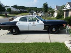 1977 Plymouth Fury police black and white patrol car