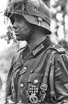 This is an OFFICER CANDIDATE for the Heer (Army) in a Panzergrenadier Unit before the Battle of Stalingrad. He has won or earned the Iron Cross (1st and 2nd Class), Infantry Assult Badge in Silver, Armor Assult badge in Bronze, a ribbon (MIGHT be the for the Russin Front), and lastly Wound Badge in Black or Silver. Information found in Panzergranadiers in Action from Squadron/Signal Publications... Page 30. Also the likeness was drawen for the Cover of the book.