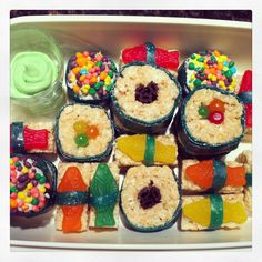 Candy sushi made out of Rice Krispies, fruit roll ups, twizzlers, mike and Ike's, and nerds! oh and green icing as wasabi!