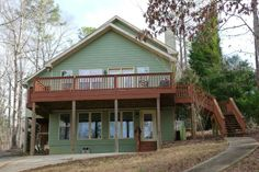 Expired Jacksons Gap, AL 36853  MLS #14-213 Exceptional lakehome has good summer water&the KING of ALL 2-story lake partydocks,covered boat house+boatlift.Bring ALL your friends & family-5BRS,3 full baths,hardwood floors,fireplace,massive main level great room,lower level family/game room w/kitchenette.Private master suite on upper level has open loft 3rd den,balcony.Screened porch.Covered patio,deck.Gazebo at lakeside. #lakemartin #realestate #alabama