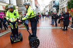 Makes you feel nostalgic for the old Panda car! Garda Eabhach Dineen and Garda David Campbell, from Pearse Street station, show off the Segway as a means of patrolling, at the launch in Grafton Street, Dublin. Photograph: Eric Luke/Irish Times
