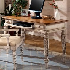 What a great distressed, wooden, English dovetail desk! Love the look of this and the roll-out keyboard tray.