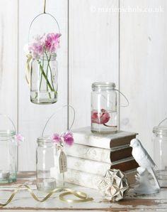 Flores en botes de cristal