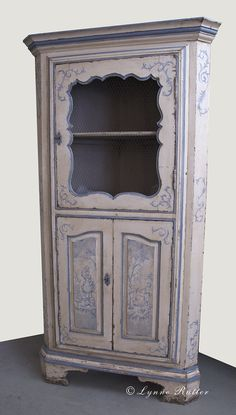 ivory painted corner cupboard with  Provinçal designs    Lynne Rutter | Murals and Decorative Painting | Classes