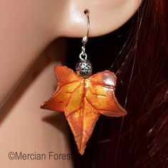 Welcome to our listing for a simple, yet elegant pair of Ivy Leaf earrings in Early Autumn Tones.  Hand Sculpted from Polymer Clay, Hand Painted to give depth and detail and finished with a Pentacle bead just below a Sterling Silver earring hook.  As our Polymer Clay items are made by our own fair hands we are able to customise each piece to fit your requirements. If you would like a different colour or alterations made to the design we are happy to do this, free of charge. Simply drop us a… Pagan Jewelry, Fall Jewelry, Early Autumn, Ivy Leaf, Leaf Earrings, Wiccan, Sculpting, Polymer Clay, Pendant Necklace
