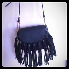 Vegan Leather Blair Fringe Fold over crossbody bag Fold over fringe cross-body bag made from Vegan Leather. An animal cruelty free purchase along with a bag that holds your personal belongings, makes a statement and is a trendy/ Fashion Forward accessory. Brand new with tags. Never worn. Navy Blue. Melie Bianco Bags Crossbody Bags