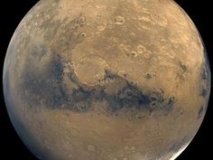 This photo released by NASA shows a view of Mars that was stitched together by images taken by NASA's Viking Orbiter spacecraft.