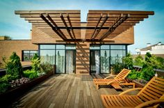 Modern Terrace with Wooden Deck and Pergola