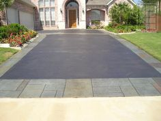 Yorkstone Stamped band on Driveway with stained concrete interior - PC By Rey