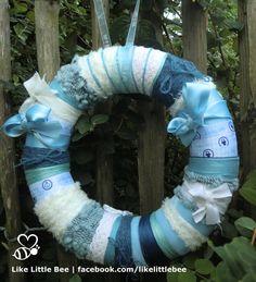 Kraamkrans jongen met wol, band en lint