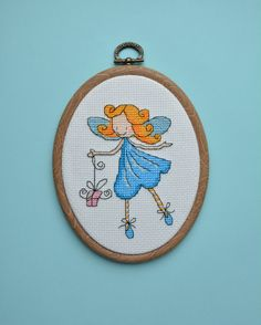 Blue fairy with a gift - Completed Cross Stitch, Nursery Wall Decor, Wall Hanging, Hand embroidery, Hoop art - pinned by pin4etsy.com