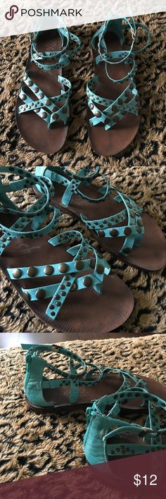 Gladiator studded sandals Blowfish Blowfish gladiator teal studded sandals, small crack in the leather on right sandal back heel (pictured), bottoms are in barely worn condition. Only wore a few times Blowfish Shoes Sandals