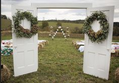 Fall wedding. Old doors used as entrance. Bales of hay covered with quilts as seating. Altar of flowers.