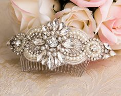Elegant crystal wedding hair comb is made with high quality crystal and pearl applique of my original design. It can be worn with a traditional style veil or a birdcage veil. It is a also a perfect hair accessories to adorn your wedding hair or for any other special occasion. *Crystal embellishment measures 6 long and 2 wide. *Attached to 3 3/4 metal hair comb. *Available in silver or rose gold colors. *Pearls are light ivory. WEDDING DATE: When placing your order please let us know your...