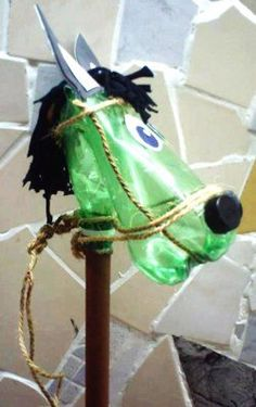 Craft Ideas Plastic Bottles on Recycling Plastic Bottle And More Crafts Ideas Crafts For Kids Plastic Bottle Cutter, Plastic Bottle Flowers, Plastic Bottle Crafts, Recycle Plastic Bottles, Recycled Bottles, Recycled Crafts, Coke Bottle Crafts, Deco Kids, Hobby Horse