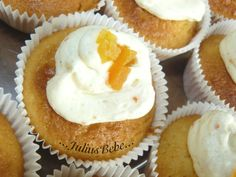 Cupcakes with cinnamon and orange slices frosting and dried apricots on top.
