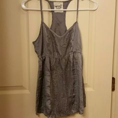Cute grey Polyester racerback tank top w/lace*$12 Very Like new. Very silky feeling.  100% polyester.  Machine was with delicate items  Willing to add this to any 7-15 piece bundle for aprox $12 after bundle discount!! That is saving you 35-50% off the retail price!   The more you spend the more you save!!! I prefer not to ship out any orders under $15!!! Kirra Tops Camisoles