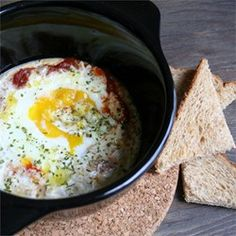 "Chef John's Baked Eggs Recipe - ""If you enjoy huevos rancheros, you will love this. The way the spicy sauce mingles with just barely set eggs is very similar, and when you start scooping this up with toasted chunks of bread, it gets borderline magical. Egg Recipes, Brunch Recipes, Great Recipes, Cooking Recipes, Favorite Recipes, Cooking Videos, Recipe Ideas, Waffle Recipes, Amazing Recipes"