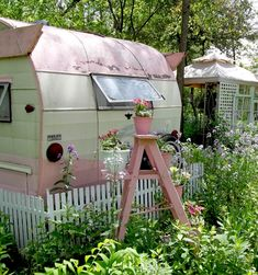 Vintage pink cottage camper. They found a pretty spot and just stayed put.