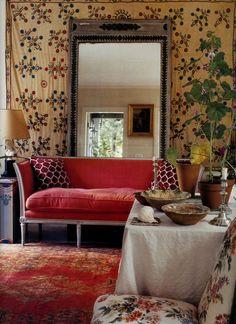 sofa + cushions + mirror + textiles