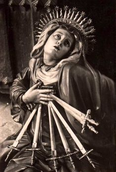 mater dolorosa. our lady of seven sorrows in the church of san miguel in valladolid, spain.