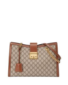 2d5a3f65012 Get free shipping on Gucci Padlock GG Supreme Canvas Medium Shoulder Bag at  Neiman Marcus.
