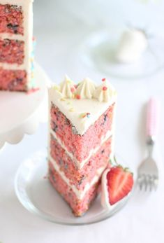 Strawberry Confetti Cake -Three decadent, moist strawberry layers of cake with a vanilla bean Swiss meringue buttercream with the perfect amount of confetti sprinkles.