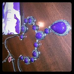 Beautiful purple necklace NWT chunky statement necklace with antique silver metal. Very pretty necklace. The necklace is adjustable from 21 to 23 inches. Pendent drop is 3 1/2 inches down. Jewelry Necklaces