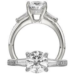 Classic engagement ring featuring a round cut centerstone with royal crown undergallery and tapered baguette side stones with a micropavé single row diamond shank.