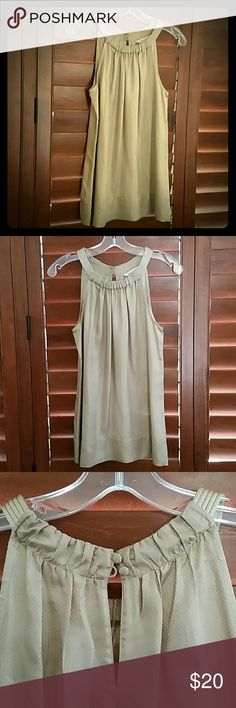 Gold sleeveless blouse Gold sleeveless blouse aline shape roused collar. Slightly textured material.  Excellent condition. White House Black Market Tops Blouses
