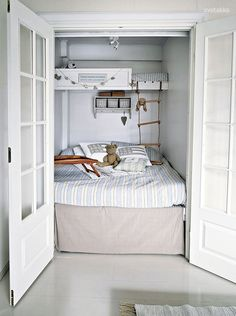 Bed and loft in a converted closet. Switch out normal doors for doors with windows