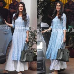 Kriti Sanon in classic chikankari kurti pants set from in a casual day out 🌟🌟🌟 KritiSanon chikankariembroidery lucknowi … is part of Indian kurti designs - Indian Gowns, Indian Attire, Pakistani Dresses, Indian Wear, Kurtis Indian, Bollywood Dress, Salwar Designs, Kurti Designs Party Wear, Simple Kurti Designs