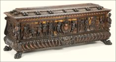 A pair of Italian Renaissance carved walnut and parcel-gilt cassoniprobably Rome, third quarter 16th Century