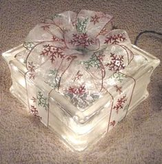 Glass Block_ Gift-Wrapped    hole drilled and string of 35 clear lights inside. Add beautiful bow and you have a special present to decorate with!